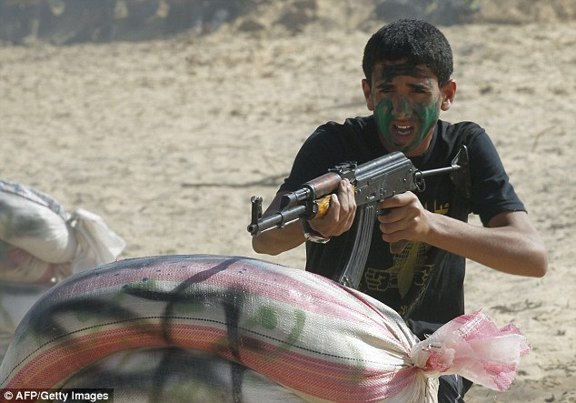 Target practice: A future fighter aims his gun at the camp which aims to mould the terrorists of tomorrow