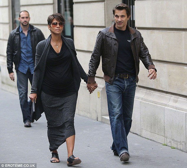 Parents to be: The actor and his fiance Halle are in Paris for the film festival
