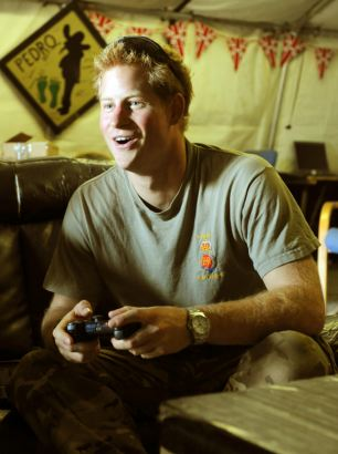 Prince Harry plays computer games with his crew during their 12-hour shift at the British controlled flight-line in Camp Bastion southern Afghanistan, where he is serving as an Apache Helicopter Pilot/Gunner.