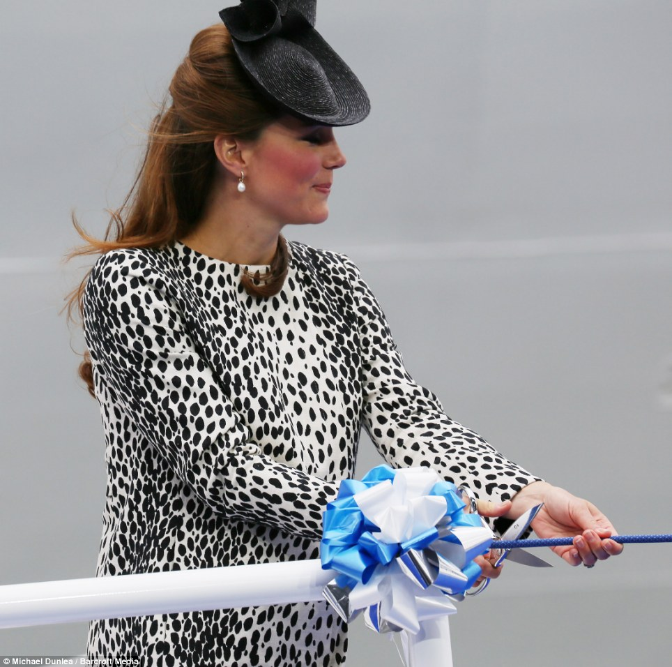 Ready...steady... The Duchess of Cambridge prepares to christen the Royal Princess with a £1,250 nebuchednezzar of Moet & Chandon champagne