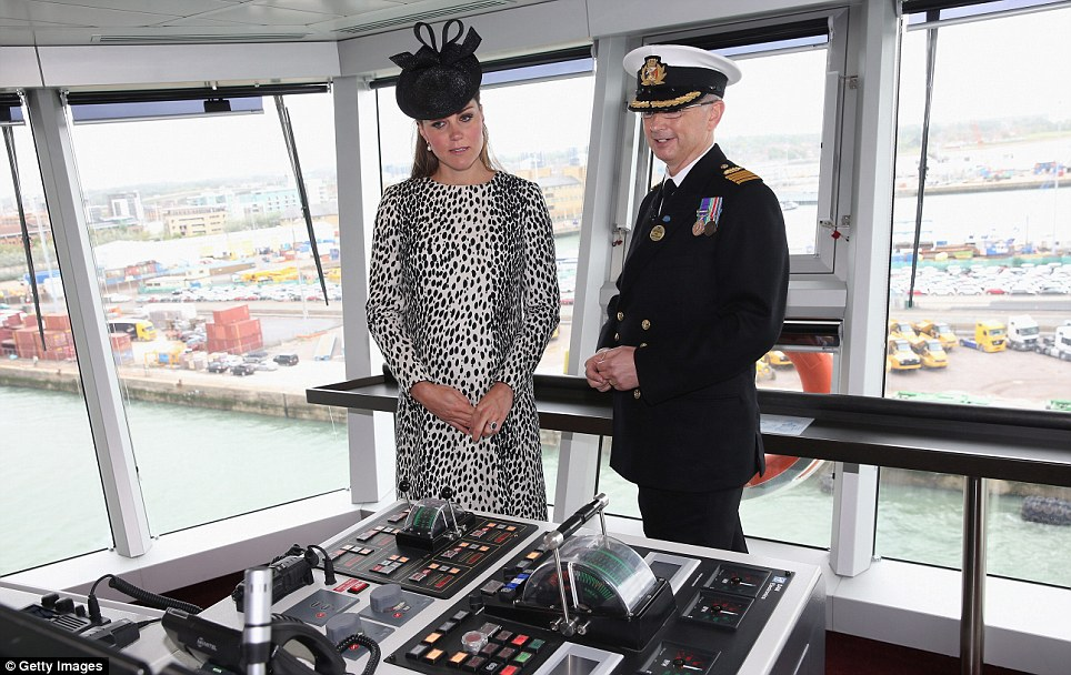 Driver's seat: Captain Tony Draper gives the Duchess of Cambridge a guided tour of the Royal Princess' high tech Bridge