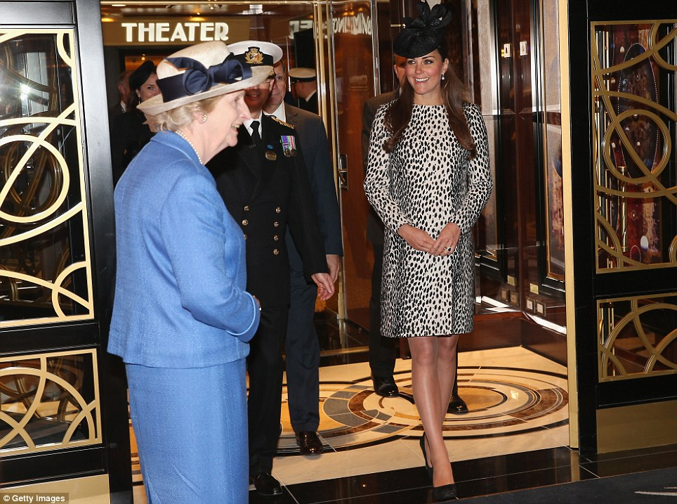 Grand entrance: The Duchess of Cambridge strides through the ship's opulent atrium during a tour on the arm of commanding officer, Captain Tony Draper