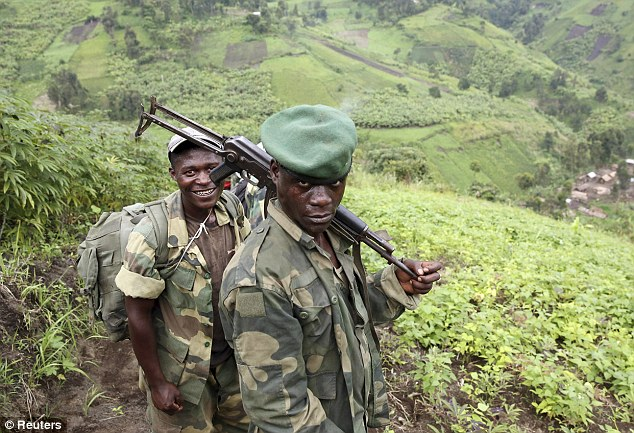 M23 rebel fighters rest as they withdraw near the town of Sake, some 42 km (26 miles) west of Goma. The rebellion, began in 2012 but has already led to around 800,000 people being forced to flee their homes