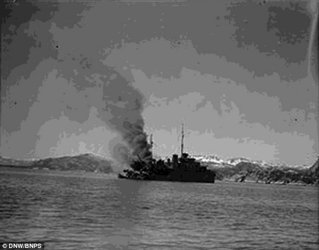 Resilient: Commander Ian Forbes survived his first sinking while on HMS Bittern, pictured smoking after being hit, only to escape from going down with his ship on three more occasions during World War II