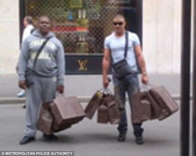 Two of the pushers are seen here laden with bags of designer goods outside a Louis Vuitton store in Paris