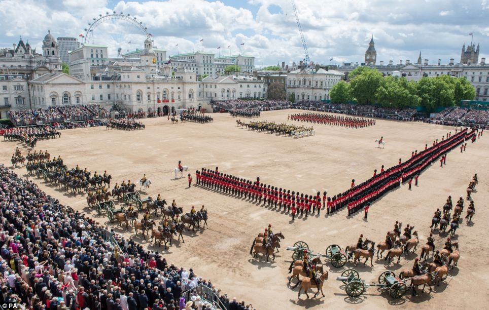 Soldiers from the Household Division line up in a precise formation before royalty and the public during the Trooping the Colour at Horse Guards Parade
