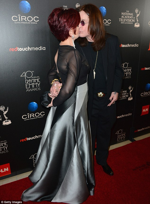 Passionate embrace: Ozzy and Sharon Osbourne shared a passionate kiss on the red carpet for the Daytime Emmy Awards in Beverly Hills, on Sunday night