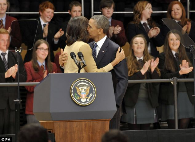 Supportive: Obama hugs his wife Michelle Obama, before delivering a keynote address