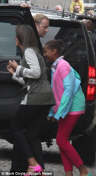 Well that's over! Sasha Obama looks delighted to be heading back to the hotel in Dublin