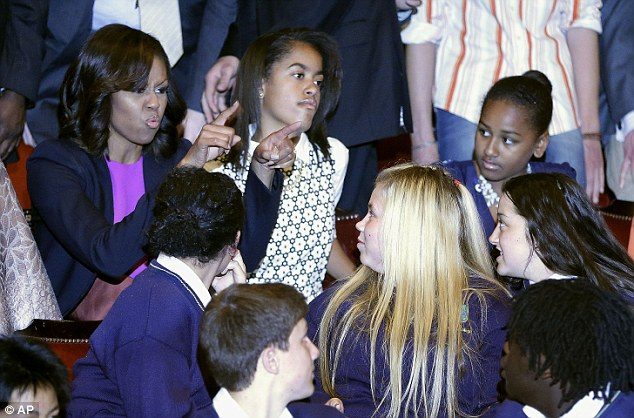 Telling off? The First Lady gestures to students who attended a performance of Riverdance along with the First Lady and her daughters on Monday night in Dublin
