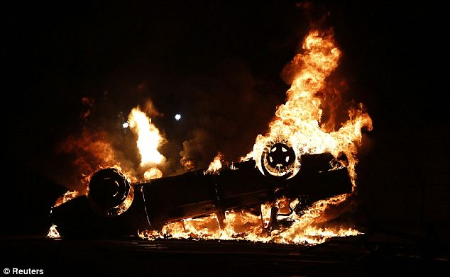 Anger: A car burns during a protest in downtown Rio de Janeiro
