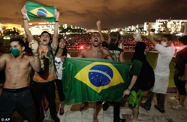 Disgruntlement: Demonstrators shout slogans on the ramp of the Brazilian National Congress during protests in Brasilia