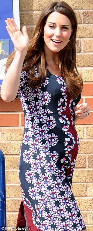 Catherine, Duchess of Cambridge visits Willows Primary School in Manchester, on St George's Day when six months pregnant