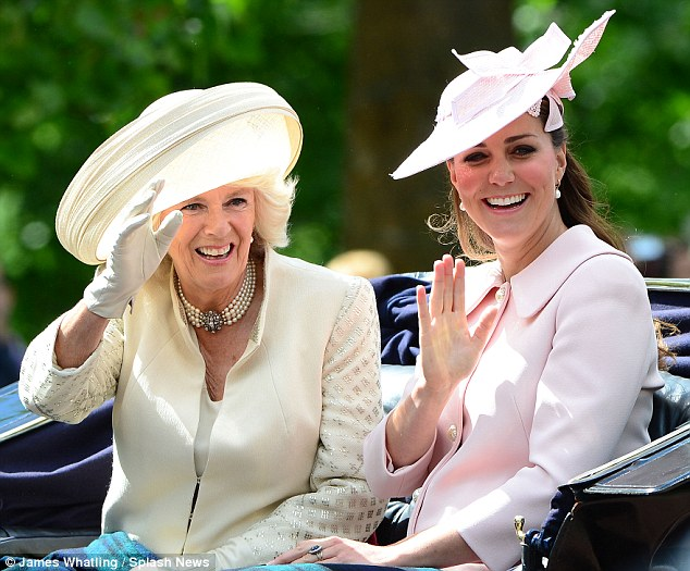 Preparations: Kate looked happy as she sat with the Duchess of Cornwall on Saturday, as details of Palace preparations for her labour became public