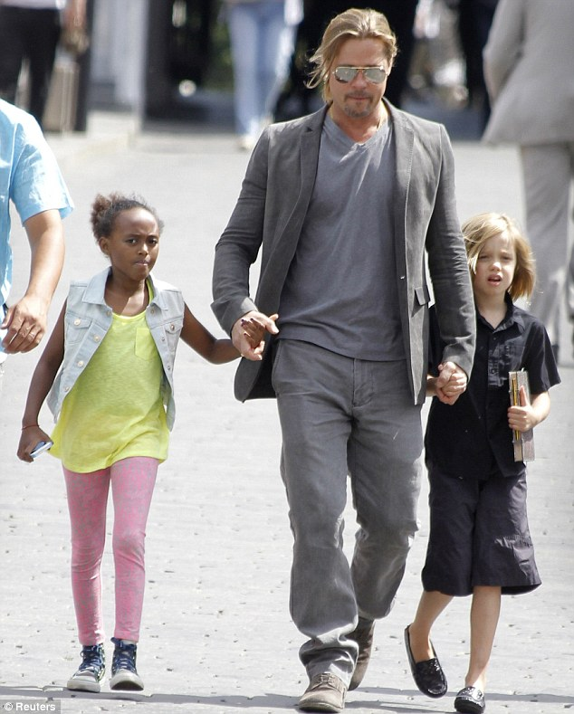 Daddy;s girls: Brad Pitt strolls through Moscow, Russia with daughters Zahara and Shiloh on Thursday