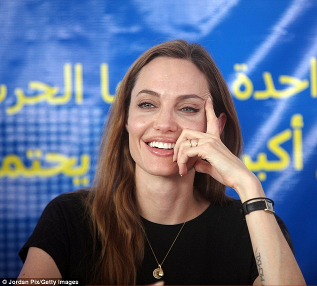 Humanitarian: Not seen Friday was his fiancée Angelina Jolie, who's on the Jordanian-Syrian border talking to refugees as part of her work with the United Nations