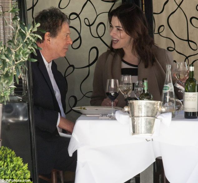 Happier times: When the couple met at a private dinner Saatchi was reportedly immediately totally captivated. But as her career has flourished he has apparently became less comfortable