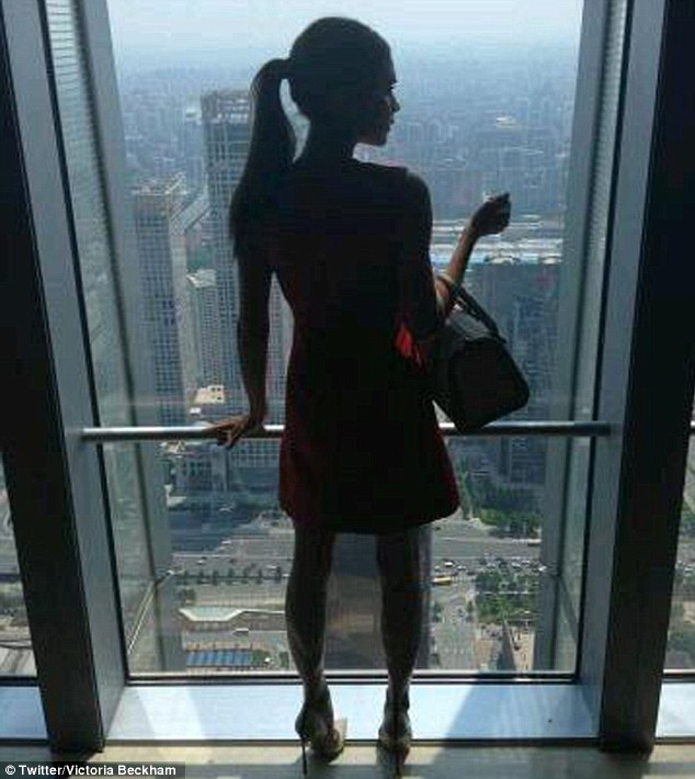 What a beautiful view: Victoria tweeted a snapshot of herself wearing the dress in front of Bejing's spectacular cityscape