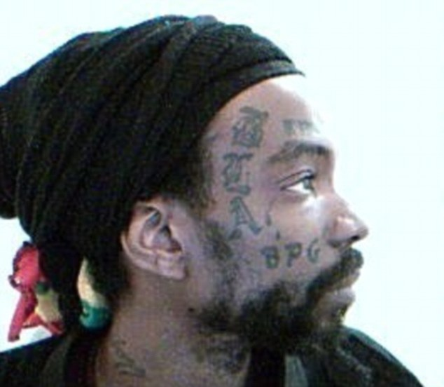 Heath's entire face is covered in 'black power' tattoos including one not pictured here which reads 'Kill Whitey' described by Urban Dictionary as a phrase yelled to intimidate white prisoners in prison