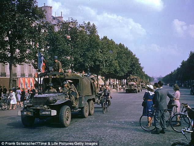 American Army trucks parade down the Champs-Elysées the day after the liberation of Paris by French and Allied troops, August 1944