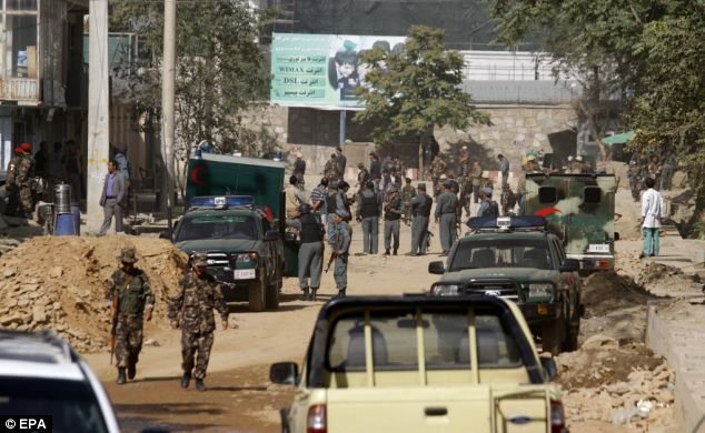 Secure: Afghan security officials secure the scene of a gunfight between Taliban militants and Afghan security officials