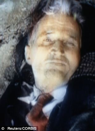 Ceausescu lays dead at the foot of a wall after reportedly being executed by Romanian military Dec. 25. Image taken from Romanian TV footage