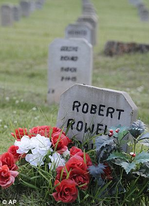 The headstone of Robert Powell (left), who was the 354th prisoner to be executed in Texas since 1982 and Karla Faye Tucker (right),