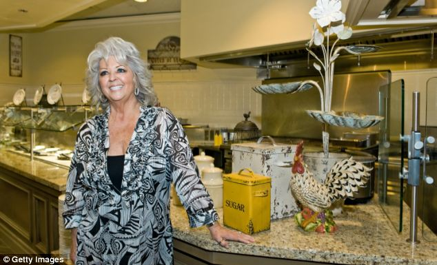 The shamed chef pictured at the grand opening of Paula Deen's Kitchen at Chicago Harrah's Joliet Casino & Hotel last April - the restaurant will now be rebranded