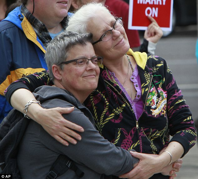 Pleaed: Julie Weismann and MarDee Hansen embrace during a pro-gay-marriage rally in Eugene, Oregon