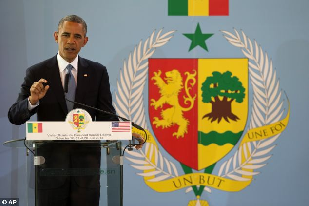 Defiant: Speaking from his trip to Senegal, President Obama said the U.S will not be 'scrambling jets' to seize Edward Snowden, saying Russia should hand him over through proper legal channels
