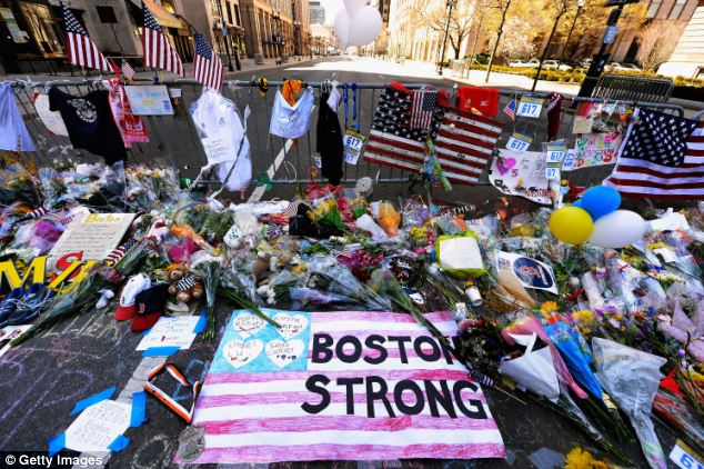 Staying strong: A makeshift memorial was set up for victims of the bombings near the marathon finish line