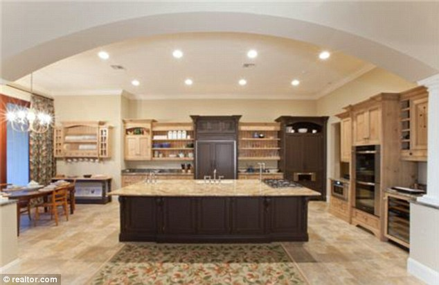 Family kitchen: The $8.7 million property has a well-equipped kitchen and dining area