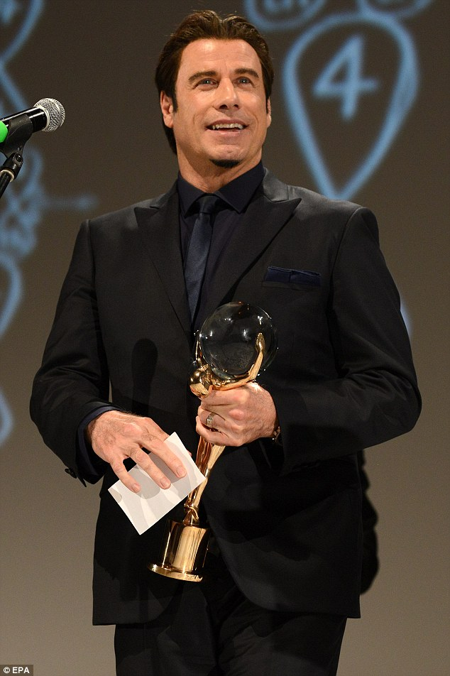 John Travolta Receives Crystal Globe Award At Czech Film