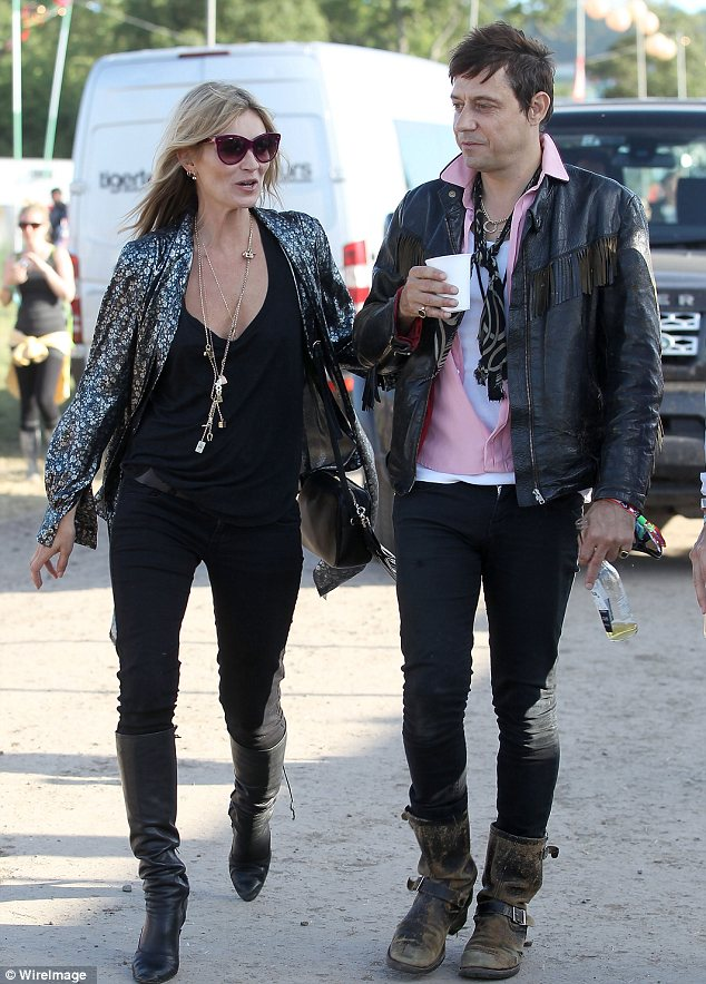 Cool customers: Kate Moss and Jamie Hince arrived at Glastonbury on Saturday in complementing looks