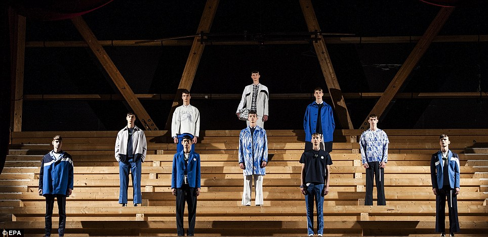 Like a fashion army, models in blue and a variety of jacket styles lined up on steps during the Kenzo SS14 show