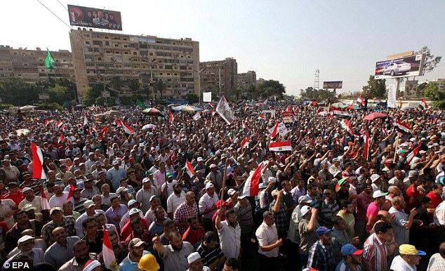 Making a point: Egyptians supporting President Morsi wave their national flag and shout slogans during a protest in Cairo