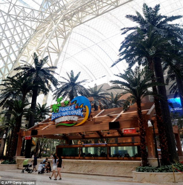 Family fun: As well as the shops, hotels and the artificial sun, the building also has an indoor water park