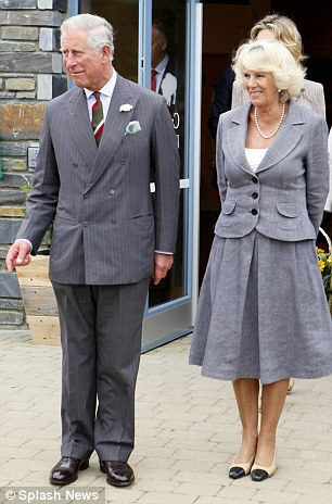 Grandparents: Camilla was joined by her husband Prince Charles for the visit to the 2,500 acre organic farm