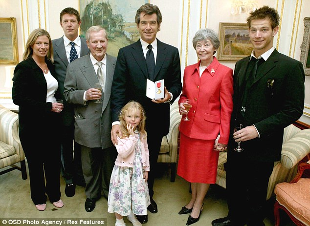Proud moment: Pierce with (L-R) Charlotte, Christopher, his father Bill, Charlotte's daughter Isabella, his mother May and son Sean collecting his Irish OBE in July 2003