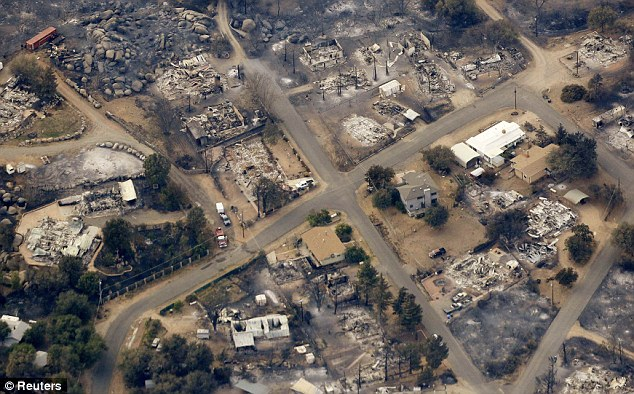 Shattered: The small town is reeling after the deaths of 19 brave firefighters in the fierce blaze on Sunday
