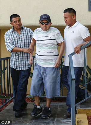Antonio Lopez Chaj (centre) had to be supported by relatives at the news conference on Monday