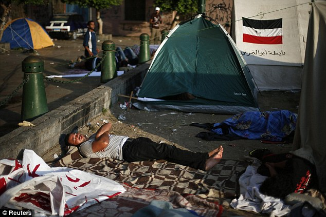 On deadline: Protesters continue to camp out at Tahrir Square this morning as the 48 hour military ultimatum to find a resolution to the uprising fast approaches