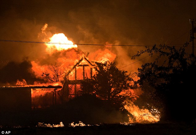 Raging Inferno: A home burns amidst the Yarnell Hill Fire in Yarnell, Ariz. on Sunday, June 30, 2013