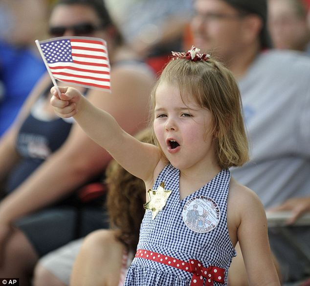 Big day: 3-year-old Kennedy Kemper enjoys the Clawson, Michigan Fourth of July parade