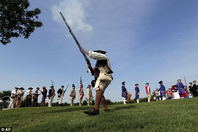 History: A group of re-enactors put on a production of the 'Shot Heard Around the World' during a ceremony at Fort Sam Houston National Ceremony in Texas on the Fourth to honor the patriotic day