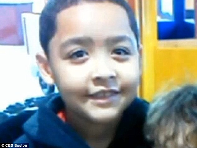 Drenched: Joshua Garcia, 8, ran almost a mile home while barefoot and soaking wet to have his mother call 911, saving his father's life
