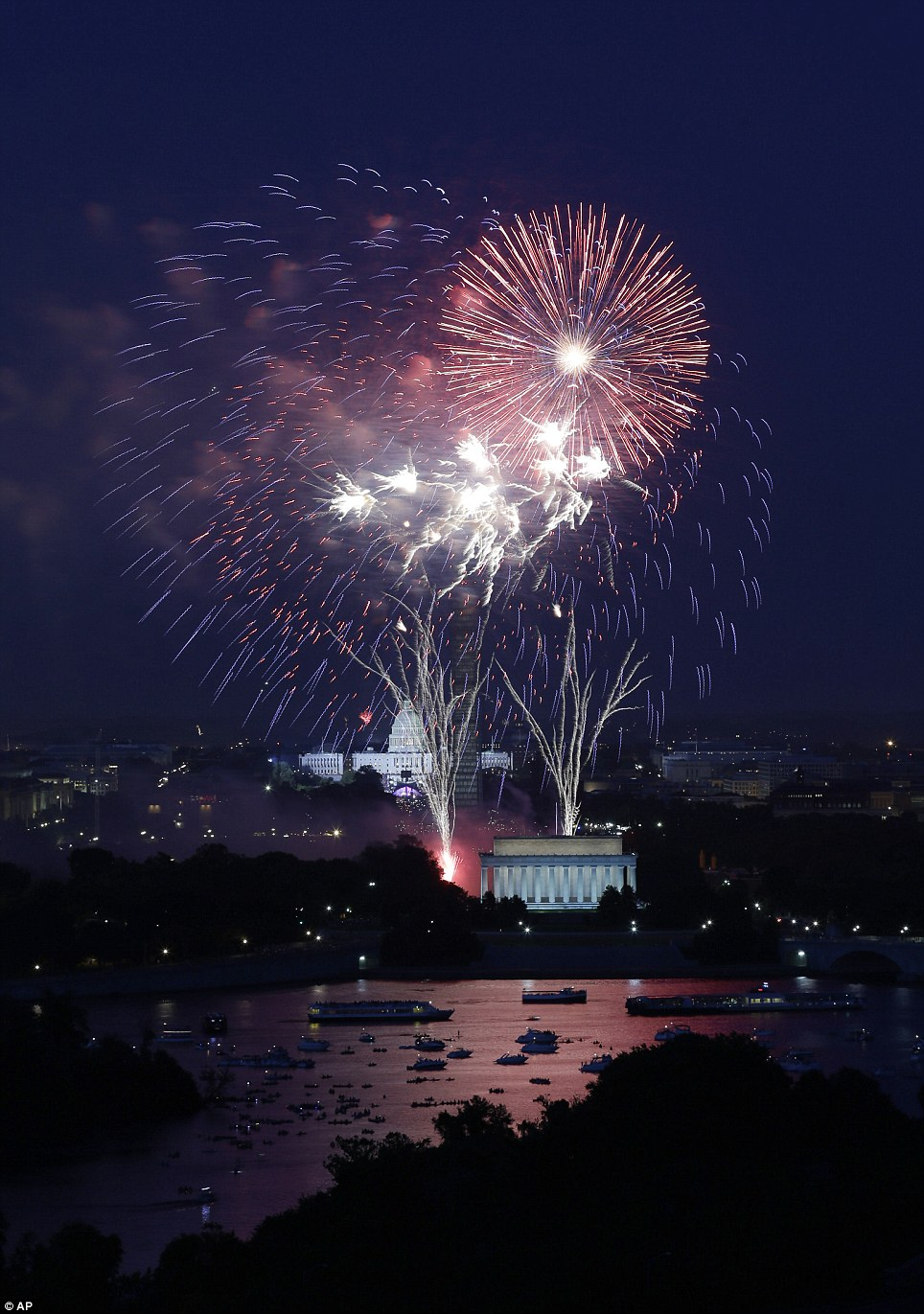 Fireworks light the sky over the U.S. Capitol, left, the Washington Monument and the Lincoln Memorial during Fourth of July celebrations, Thursday, July 4, 2013 in Washington