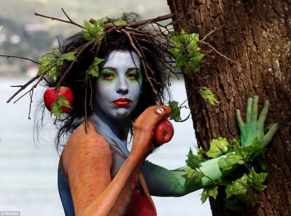 Would you Adam and Eve it? This model portrays both the Biblical serpent and an alternative Eve as she poses during the annual World Bodypainting Festival