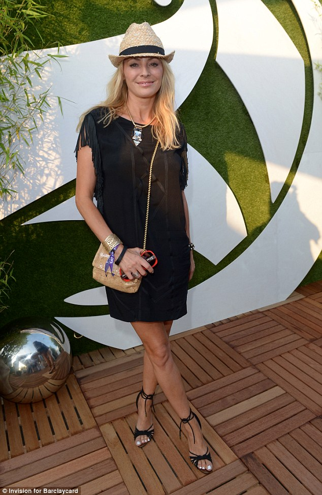 Better than ever: Tess looks stunning in a black summer dress with fringed sleeves