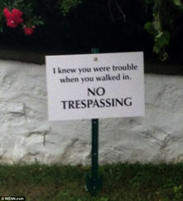 'I knew you were trouble when you walked in. NO TRESPASSING': The Sparks Fly hitmaker even put up a sign on her property referencing one of her hit songs